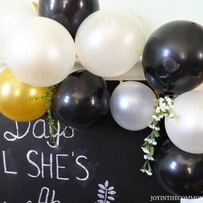 Black & Gold Balloon garland & florals